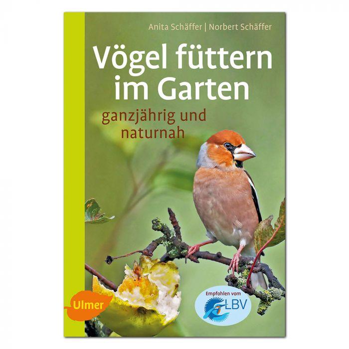 Vögel füttern in Garten